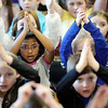 BEN GARVER — THE BERKSHIRE EAGLE<br /> Children at Allendale Elementary school go through a quick drill before watching the Kyundong University Taekwondo Team. <br /> The Kyundong University Taekwondo Demonstration Team visited Allendale Elementary School in Pittsfield for show of skill, Monday, March 8, 2019. The team also visited Morningside School.  Both schools work with Master Son of U.S. Taekwondo in Pittsfield to learn about the sport and the educational values of taekwondo.  The demonstration  is sponsored by the World Taekwondo Education Foundation (WTEF.)