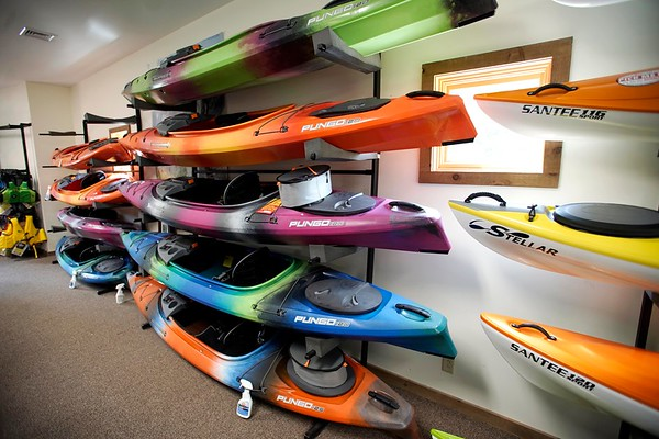 BEN GARVER — THE BERKSHIRE EAGLE<br /> Kayaks can range in price from several hundred to several thousand dollars at the Arcadian Shop in Lenox, Wednesday, August 14, 2019. Outdoor gear other than clothing will be covered over the tax free weekend.