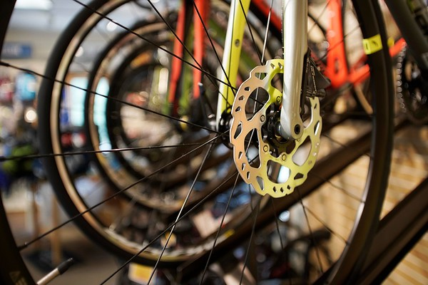 BEN GARVER — THE BERKSHIRE EAGLE<br /> Bicyle parts and components drive up the price of high-end bikes in bicycle section of the Arcadian Shop in Lenox, Wednesday, August 14, 2019.   Bicycle wheels can cost hundreds of dollars and up depending on the degree of precision of the components and their weight. Outdoor gear other than clothing will be covered over the tax free weekend.