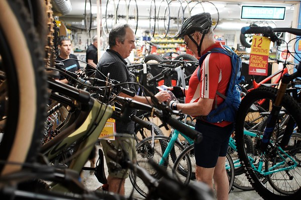 BEN GARVER — THE BERKSHIRE EAGLE<br /> Salesperson Erik Forestell talks with Peter Strauss in the bicycle section of the Arcadian Shop in Lenox, Wednesday, August 14, 2019. Outdoor gear other than clothing will be covered over the tax free weekend.