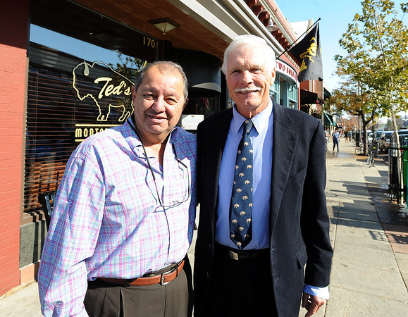 """Ted Turner poses with George Karakehian at Ted's Montana Grill. <br /> Ted Turner visited his restaurant in  Boulder on Friday to announce the start of  a buffalo ranch and receive an award.<br /> For a video and more photos of Ted Turner, go to  <a href=""""http://www.dailycamera.com"""">http://www.dailycamera.com</a>.<br /> Cliff Grassmick / October 28, 2011"""