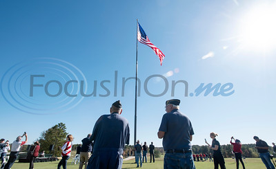 Air Force veterans John Kindt and David Spann, both of Liberty City, watch as a large flag is raised on a huge, new flagpole at Tempest Golf Club in western Gregg County on Veterans Day, Wednesday, Nov. 11, 2020.