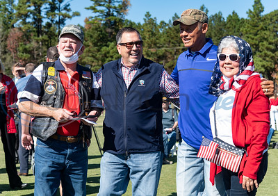 Gilmer residents Jim Lacaze, far left, and Aida Lacaze, far right, get their photo taken with State Rep. District 7 Jay Dean and county music star Neal McCoy before the flag raising ceremony at Tempest Golf Club in western Gregg County on Veterans Day, Wednesday, Nov. 11, 2020.