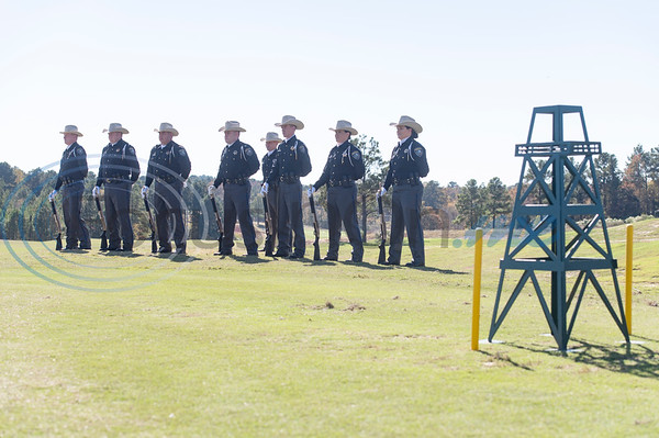 """The Gregg County Sheriff Honor Guard stands for a 21 gun salute during the flag raising ceremony at Tempest Golf Club in Gladewater on Veterans Day, Wednesday, Nov. 11, 2020. The golf course's new monument, a 208 foot tall flagpole called """"We the People"""" flies a large flag 90 by 180 feet wide."""