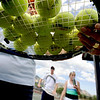 "Lois LaFond collects balls on her racket, while Wayne Werbelow and Debbie Herring, walks off the court.<br /> Tennis students workout at the CU tennis courts during the CU adult tennis camp on Sunday.<br /> For more photos of the tennis camps, go to  <a href=""http://www.dailycamera.com"">http://www.dailycamera.com</a><br /> Cliff Grassmick / June 3, 2012"