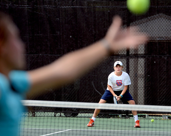 """Jackson Hawk waits for a serve from Glenna Gee-Taylor during Rocky Mountain Tennis Camp.<br /> Tennis students workout at the Rocky Mountain Tennis Camp in Boulder.<br /> For more photos of the tennis camps, go to  <a href=""""http://www.dailycamera.com"""">http://www.dailycamera.com</a><br /> Cliff Grassmick / June 3, 2012"""
