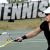 """Barbara Connors returns a ball during CU Tennis Camp.<br /> Tennis students workout at the CU tennis courts during the CU adult tennis camp on Sunday.<br /> For more photos of the tennis camps, go to  <a href=""""http://www.dailycamera.com"""">http://www.dailycamera.com</a><br /> Cliff Grassmick / June 3, 2012"""