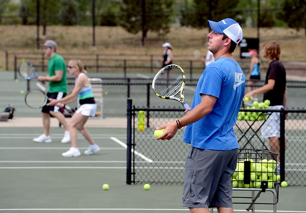 "Matt Manasse, a representative of Babolat Tennis, helps teach the CU Tennis Camp students.<br /> Tennis students workout at the CU tennis courts during the CU adult tennis camp on Sunday.<br /> For more photos of the tennis camps, go to  <a href=""http://www.dailycamera.com"">http://www.dailycamera.com</a><br /> Cliff Grassmick / June 3, 2012"