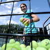 "Glenna Gee-Taylor, who plays tennis for Centaurus High, grabs some balls for a session during Rocky Mountain Tennis Camp.<br /> Tennis students workout at the Rocky Mountain Tennis Camp in Boulder.<br /> For more photos of the tennis camps, go to  <a href=""http://www.dailycamera.com"">http://www.dailycamera.com</a><br /> Cliff Grassmick / June 3, 2012"