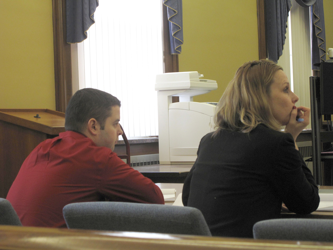 """ELIZABETH DOBBINS / GAZETTE Defendant James """"Jimmy"""" Tench listens to testimony with his lawyer Rhonda Kotnik during the murder trial of Tench's mother Mary on Monday in Medina County Common Pleas Judge Joyce V. Kimbler's court."""