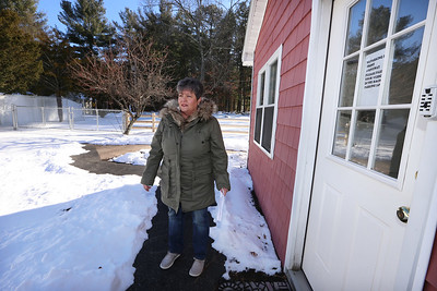 Doreen Majeau of Chelmsford, at the group home where her son Michael, 29, who has autism, lives. After complaints by the next door neighbor, the group home closed its driveway (at left) on that side, and extended a second driveway on the other side of the house and made other changes to how residents enter the house. (SUN/Julia Malakie)