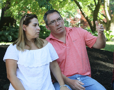 Residents of Fox Run Drive in Tewksbury have concerns about Into Action Recovery's sober home being established in the neighborhood. Edina Braga and her husband John Powers. (SUN/Julia Malakie)