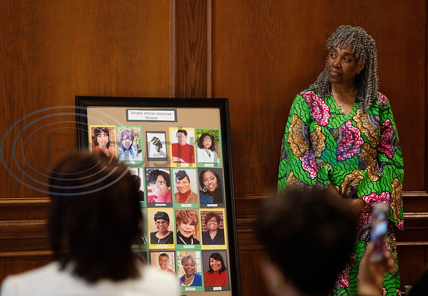 Smith County Commissioner JoAnn Hampton stands next to a photo board of the Texas African American Museum (TAAM) 2020 Notable African American Women honorees at the Rose Garden Center in Tyler on Tuesday, Feb. 18, 2020. Texas African American Museum is located in Tyler at 3000 N. Border Ave. Hampton was one of the women honored at the event.  (Sarah A. Miller/Tyler Morning Telegraph)