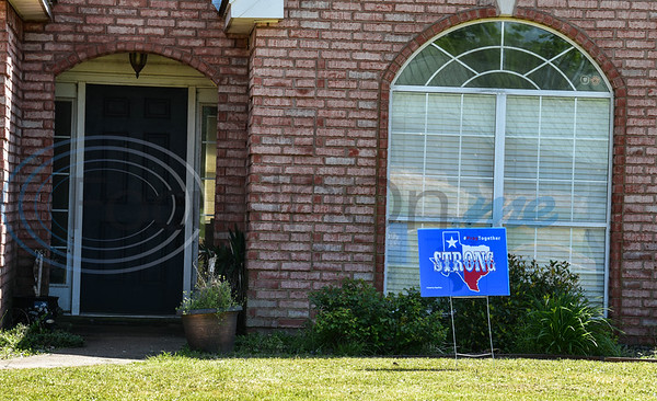 A local resident displays a Texas Strong, Pray Together sign in their front yard on Wednesday, April 15. The signs, made by iSignShop in Jacksonville, are meant to bring hope and joy to the community while struggling with the difficulties of the Coronavirus pandemic.