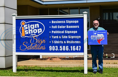 iSignShop Owner Jack Webb stands with a Texas Strong, Pray Together sign the company created to hand out free of charge to local residents and businesses. The signs come at a time when many businesses are shutting their doors and employees are being laid off due to the Coronavirus pandemic.