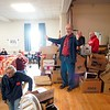 BEN GARVER — THE BERKSHIRE EAGLE<br /> Rev. Joel Huntington speaks before volunteers for the Thanksgiving Angels distribute about 1400 Thanksgiving meals to families in need, Monday, November 25, 2019. 380 volunteers are needed to distribute the food and deliver it to people who cannot make the trip.