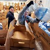 BEN GARVER — THE BERKSHIRE EAGLE<br /> Mary Gaylord and Patrick Gable work to get frozen turkeys distributed at South Congregational Church in Pittsfield as the Thanksgiving Angels distribute food to 1400 families for the holiday, November 25, 2019. The entire kitchen is filled with frozen turkeys.