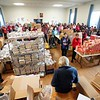 BEN GARVER — THE BERKSHIRE EAGLE<br /> Volunteers for the Thanksgiving Angels gather to distribute about 1400 Thanksgiving meals to families in need, Monday, November 25, 2019. 380 volunteers are needed to distribute the food and deliver it to people who cannot make the trip.