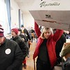 BEN GARVER — THE BERKSHIRE EAGLE<br /> Volunteer Gretchen DeBartolo carries an empty box through the crowd at South Congregational Church in Pittsfield as the Thanksgiving Angels distribute food to 1400 families for the holiday, November 25, 2019.