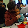 KRISTOPHER RADDER — BRATTLEBORO REFORMER<br /> Rebecca Lalanne helps feed her daughter Clara during the annual Thanksgiving luncheon at Vernon Elementary School on Thursday, Nov. 15, 2018.