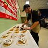 KRISTOPHER RADDER — BRATTLEBORO REFORMER<br /> Ian Deyo, a food service worker, prepares different types of pies during the annual Thanksgiving luncheon at Vernon Elementary School on Thursday, Nov. 15, 2018.