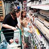 BEN GARVER — THE BERKSHIRE EAGLE<br /> Kristen Daigle checks out beauty products with her daughters Lila, 10, and Maci, 4,  at the Berkshire Food Co-op. <br /> The Berkshire Food Co-op has moved to Powerhouse Square next to its former location and is bustling with activity, Wednesday, June 19, 2019.