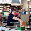 BEN GARVER — THE BERKSHIRE EAGLE<br /> Kristen Daigle checks out at the Berkshire Food Co-op. <br /> The Berkshire Food Co-op has moved to Powerhouse Square next to its former location and is bustling with activity, Wednesday, June 19, 2019.