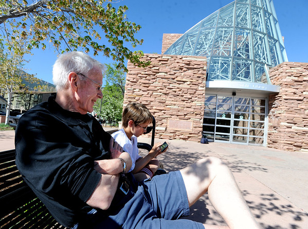 "Sheldon Hendricks waits with his grandson, Elliot Hendricks, for the Boulder Public Library to open on Saturday.<br /> For more photos of the library, go to  <a href=""http://www.dailycamera.com"">http://www.dailycamera.com</a>.<br /> Cliff Grassmick / April 21, 2012"