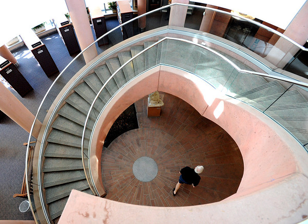 """Sheldon Hendricks walks through the bottom floor of the Boulder Public Library on Saturday.<br /> For more photos of the library, go to  <a href=""""http://www.dailycamera.com"""">http://www.dailycamera.com</a>.<br /> Cliff Grassmick / April 21, 2012"""