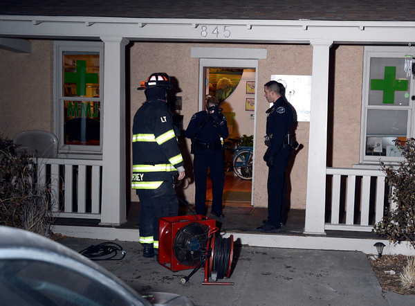 Boulder Police officers and firefighters investigate The Dandelion Dispensary after an alleged robbery on Thursday, Jan. 3, in Boulder. The suspects fleed the scene and allegedly used some sort of pepper spray while robbing the business<br /> Jeremy Papasso/ Camera