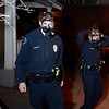 Boulder Police officer F. Rodriguez, left, and another officer exit The Dandelion Dispensary with gas masks on while investigating a robbery on Thursday, Jan. 3, in Boulder. The suspects fleed the scene and allegedly used some sort of pepper spray while robbing the business<br /> Jeremy Papasso/ Camera