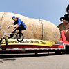 "Nick Reece, 20, of Broomfield, right, photographs his friend Taylor Bounds, 19, also of Broomfield, while looking at the giant potato during The Famous Idaho Potato Tour on Wednesday, April 11, at the King Soopers shopping center on 136th Avenue in Broomfield. For a video about the giant potato truck go to  <a href=""http://www.dailycamera.com"">http://www.dailycamera.com</a><br /> Jeremy Papasso/ Camera"