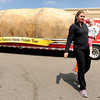 "Sarah Smith and her daughter Lily, 3, smile after looking at the giant potato during The Famous Idaho Potato Tour on Wednesday, April 11, at the King Soopers shopping center on 136th Avenue in Broomfield. For a video about the giant potato truck go to  <a href=""http://www.dailycamera.com"">http://www.dailycamera.com</a><br /> Jeremy Papasso/ Camera"