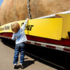"Westly Dittberner, 3, of Northglenn, stands on his tippy toes to get a feel of the giant potato during The Famous Idaho Potato Tour on Wednesday, April 11, at the King Soopers shopping center on 136th Avenue in Broomfield. For a video about the giant potato truck go to  <a href=""http://www.dailycamera.com"">http://www.dailycamera.com</a><br /> Jeremy Papasso/ Camera"