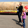 "Erin Baldwin, Noah, 2, and Maddie, 5, check out the giant potato during The Famous Idaho Potato Tour on Wednesday, April 11, at the King Soopers shopping center on 136th Avenue in Broomfield. For a video about the giant potato truck go to  <a href=""http://www.dailycamera.com"">http://www.dailycamera.com</a><br /> Jeremy Papasso/ Camera"
