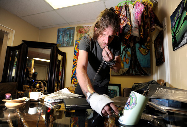 Lafayette artist Joshua Dusk takes a break from drawing while consuming marijuana with a vaporizer on Friday, Feb. 1, at The Front Tea & Art Shop in Lafayette.<br /> Jeremy Papasso/ Camera