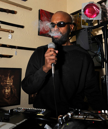 Musician Akilimanjaro blows out a hit of marijuana vapor while playing music and consuming marijuana with a vaporizer on Friday, Feb. 1, at The Front Tea & Art Shop in Lafayette.<br /> Jeremy Papasso/ Camera