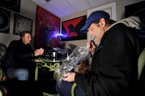 Craig Carnahan, of Lafayette, at right, takes a hit from a bag of marijuana vapor while consuming marijuana with a vaporizer as he sits next to Carl Hedberg, at left, on Friday, Feb. 1, at The Front Tea & Art Shop in Lafayette.<br /> Jeremy Papasso/ Camera