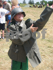 Jack Zerman, 6, of Valley City, tries on German World War II gear at a battle re-enactment at Heritage Park in Brunswick on Sunday, July 18, 2010.