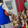 KRISTOPHER RADDER — BRATTLEBORO REFORMER<br /> Daquawn Richards, a member of the Harlem Rockets, hypes up the crowd of students at Academy School on Friday, March 15, 2019.
