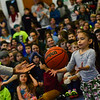 KRISTOPHER RADDER — BRATTLEBORO REFORMER<br /> Daquawn Richards, a member of the Harlem Rockets, tosses the ball back and forth with Imari Armata, a first-grader at Academy School, as they play a game with nine other people on Friday March 15, 2019.