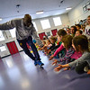 KRISTOPHER RADDER — BRATTLEBORO REFORMER<br /> Rudy Johnson, vice president of the Harlem Rockets, gives high-five to students sitting in the front row at Academy School on Friday, March 15, 2019.