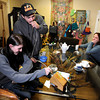 Rudy Capuchio, of Lafayette, center, takes a hit of marijuana from a vaporizer while smoking with Kyrie Wozab, of Louisville, left, and Heidi Perreria, of Lafayette, right, on Wednesday, Jan. 2, at The Hive Co-Op Cannabis Club in Lafayette.<br /> Jeremy Papasso/ Camera