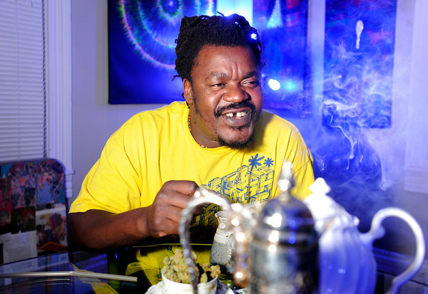 Bongo Love, of Lafayette, exhales a hit of marijuana while smoking out of a vaporizer on Wednesday, Jan. 2, at The Hive Co-Op Cannabis Club in Lafayette.<br /> Jeremy Papasso/ Camera