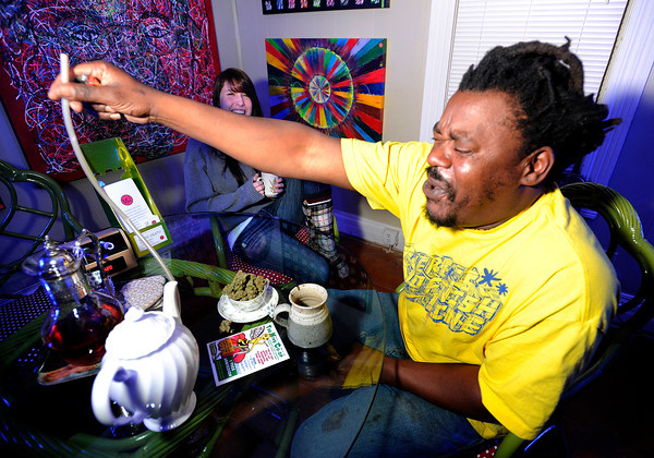 Bongo Love, of Lafayette, coughs after taking a hit of marijuana with a vaporizer on Wednesday, Jan. 2, at The Hive Co-Op Cannabis Club in Lafayette.<br /> Jeremy Papasso/ Camera