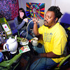 Bongo Love, of Lafayette, takes a hit of marijuana from a vaporizer while sitting next to Kyrie Wozab, of Louisville, on Wednesday, Jan. 2, at The Hive Co-Op Cannabis Club in Lafayette.<br /> Jeremy Papasso/ Camera
