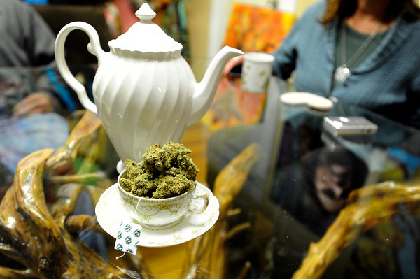 A tea pot sits on the table next to a cup of marijuana for people to consume on Wednesday, Jan. 2, at The Hive Co-Op Cannabis Club in Lafayette.<br /> Jeremy Papasso/ Camera