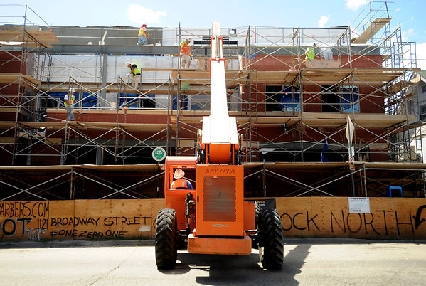 "Workers from Bighorn Stucco work on the new building at 14th and College on the Hill on Thursday.<br />  For a video of the developer, go to  <a href=""http://www.dailycamera.com"">http://www.dailycamera.com</a>.<br /> Cliff Grassmick / July 21, 2011"