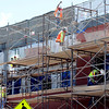 "Workers from Bighorn Stucco work on the new building at 14th and College on the Hill on Thursday. <br />  For a video of the developer, go to  <a href=""http://www.dailycamera.com"">http://www.dailycamera.com</a>.<br /> Cliff Grassmick / July 21, 2011"