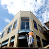 "Mario Pena paints the metal on this new building on the Hill.<br /> Work continues on the new building at the corner of 14th Street and College, which used to be the home of Jones Drug and General Store. Developer Michael Boyers is practically changing the face of The Hill.<br /> For a video of the developer, go to  <a href=""http://www.dailycamera.com"">http://www.dailycamera.com</a><br /> Cliff Grassmick / July 20, 2011"